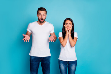 Photo of sorry pair in stupor wear casual outfit isolated blue background