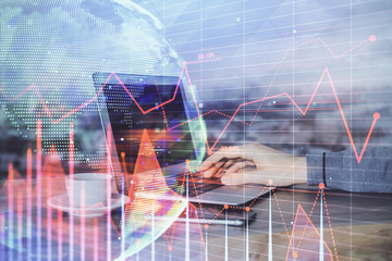 Double exposure of man doing analysis of stock market with forex graph. Concept of research and trading.