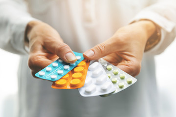 pharmacy - woman hands holding blister packs with pills