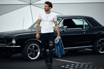 Handsome man with with a car