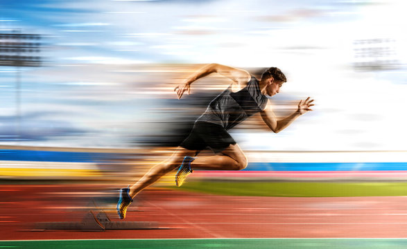 Man running on the athletic track