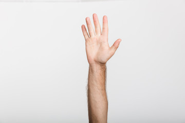 Man's hand isolated over white wall background.