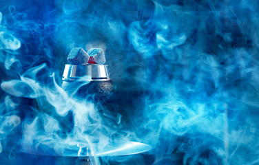 Hookah or shisha hot coals, dark black smoke background