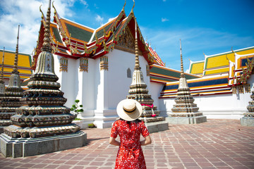Wall Mural - Woman tourist is sightseeing and visiting at Wat Pho in Bangkok, Thailand.