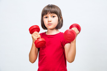happy child lifting dumbbells for girl-boy equity at sport