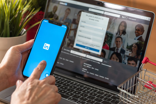 BANGKOK, THAILAND - December 29, 2018: LinkedIn human resource,  business and employment-oriented service for job career search app on mobile smart phone on iPhone device in person's hand at work