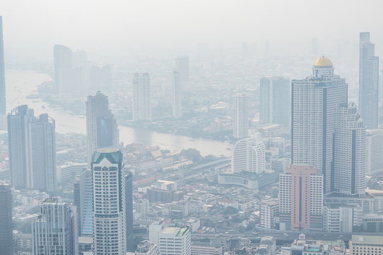 Air pollution in Bangkok with PM2.5 air-quality index (AQI) reached dangerous level with dust and smog in hazy sky, threatening to public health, rooftop view