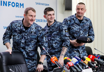 Ukrainian sailors, detained by Russia in the Kerch Strait last year and released in recent Ukraine-Russia prisoners' swap, attend a news conference in Kiev