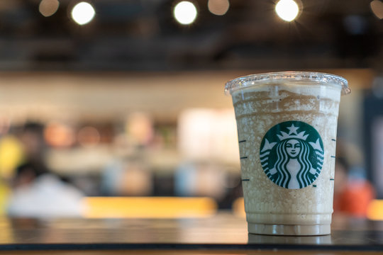 BANGKOK, THAILAND - April 6, 2019: Starbucks coffee cold beverage drink on table, famous coffee brand franchise originated in USA
