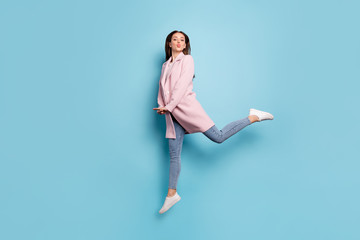 Full body photo of charming lovely girl jump have date send air kiss to her sweetheart wear season coat denim jeans isolated over pastel color background