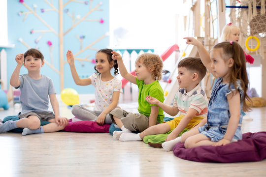 Preschool children play on speech therapy lesson in kindergarten or primary school