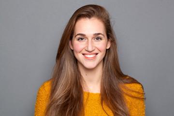 happy beautiful girl with long natural hair expressing glowing joy