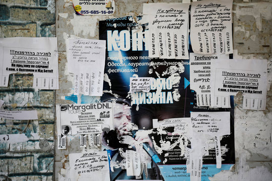 Notices written in Hebrew and Russian are seen on a board in Ashdod, Israel