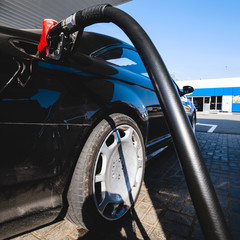 Refueling a gasoline car at a gas station