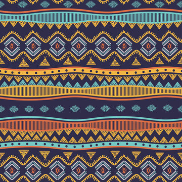 Ancient tribal hand drawn seamless pattern stripes ethnic symbols. Vector illustration ready for fashion textile print.