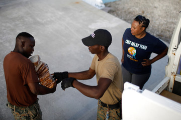 Volunteers of the NGO World Central Kitchen deliver food at the Leonard M. Thompson International Airport after Hurricane Dorian hit the Abaco Islands in Marsh Harbour