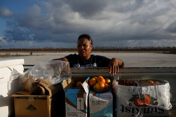 A volunteer of the NGO World Central Kitchen delivers food at the Leonard M. Thompson International Airport after Hurricane Dorian hit the Abaco Islands in Marsh Harbour