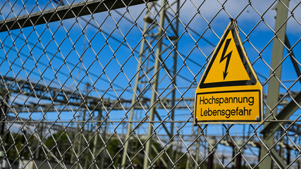High voltage sign by substation generator