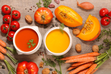 Fotobehang - carrot soup and tomato soup with ingredients