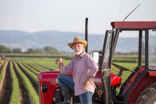 Famer standing beside tractor