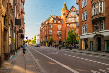 Street life in Copenhagen. People walking, riding bikes in the city center