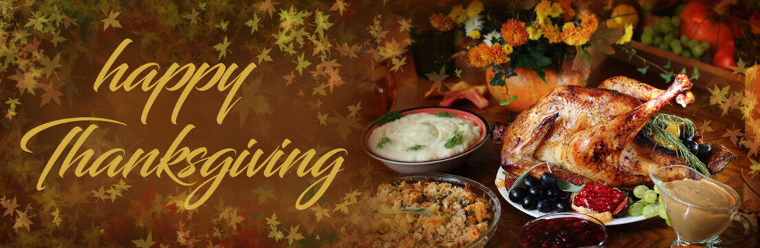 """""""Happy Thanksgiving"""" banner with the inscription. Holiday table with turkey on harvest day. Autumn shades and leaves."""