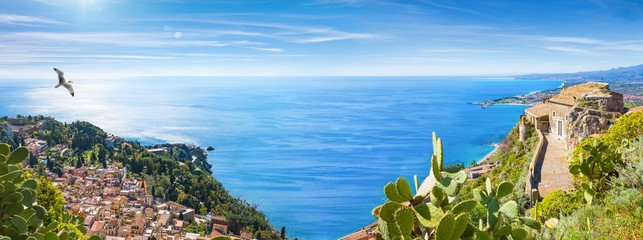 Panoramic collage with aerial view of Taormina and Church of Madonna della Rocca built on rock, Sicily, Italy. Wall mural