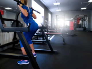 girl performs exercises in the gym