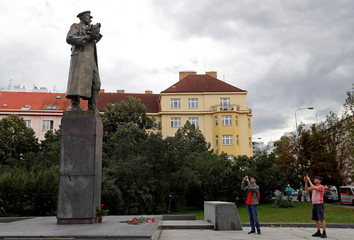 People take pictures of the monument of Soviet World War II commander Ivan Stepanovic Konev in Prague