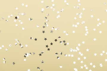 Christmas composition. Christmas golden glittering decorations on color background. Flat lay, top view, copy space - Image