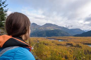 Woman looking at Resurrection River Valley at Exit Glacier, Harding Icefield, Kenai Fjords National Park, Seward, Alaska, United States