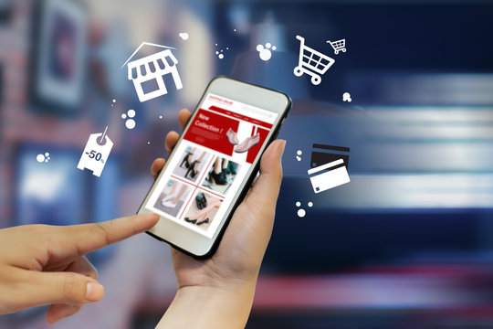Young women shopping online on smartphone