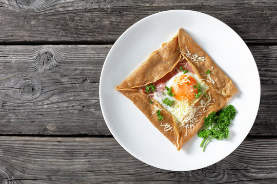 Breton crepe with egg on a white plate