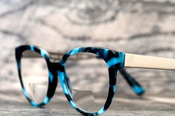 Eyeglasses Glasses with Bifocals and Black Blue Frame Fashion Vintage Style on Wood Desk Background, Rustic Still Life Style...