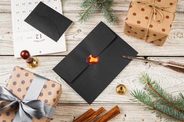 Writing Christmas post on holiday wooden decorated background