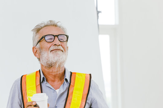 American professional worker senior engineer pleased for good work job done and ready for retirement concept