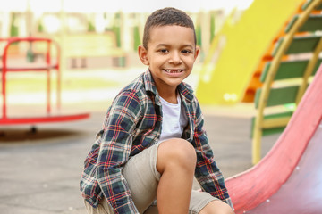 Cute little African-American boy on playground