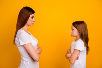 Profile side photo of negative mom and her child with long haircut looking wearing white t-shirt isolated over yellow background
