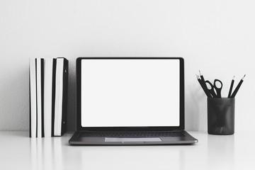 Desk top with Laptop,books,Pencil on white table arrangement concept
