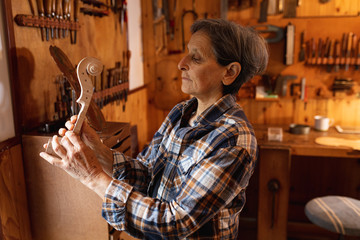 Female luthier at work in a workshop