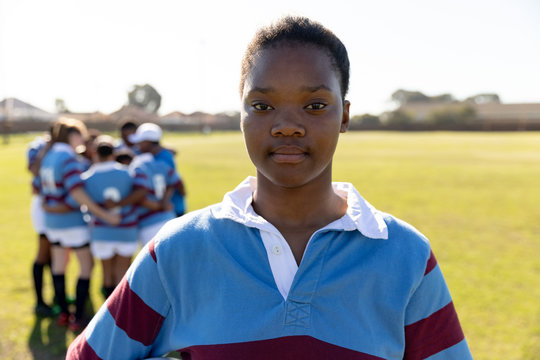 Portrait of young adult female rugby player on a rugby pitch