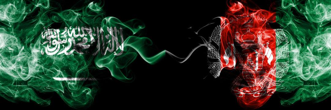 Saudi Arabia Kingdom vs Afghanistan, Afghani smoky mystic flags placed side by side. Thick colored silky smoke flags of Arabic, Arabian and Afghanistan, Afghani