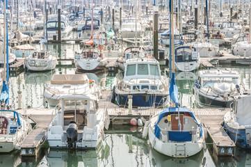 crowded yacht and boat marina - no visible trade or boat names