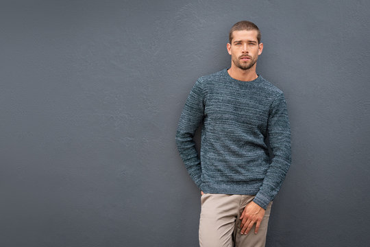 Casual fashionable man against grey wall