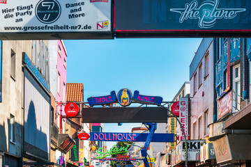 HAMBURG, GERMANY - JULY 24, 2018 : red-light district brothels and strip clubs at the Reeperbahn in Hamburg, Germany.