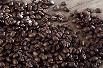 Roasted coffee beans background. Organic coffee. Close Up.
