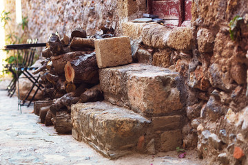 Stacked firewood near the doorstep of the house in the medieval tourist town of Monemvasia.