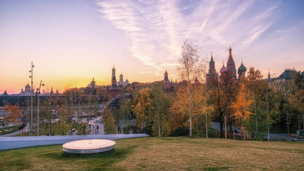 Zaryadye Park overlooking the Moscow Kremlin and St Basil's Cathedral, Russia. Zaryadye is a new tourist attraction of Moscow. Panoramic scenic view of the Moscow central park and garden in summer. Wall mural