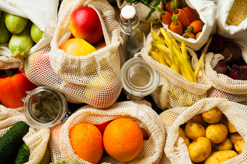 Vegetables and fruits in textile bags top view