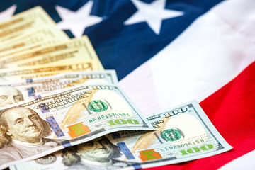 US dollar banknote on USA flag background.US dollar is main and popular currency of exchange in the world.Investment and saving concept.